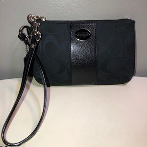 Coach black leather trim and canvas wristlet